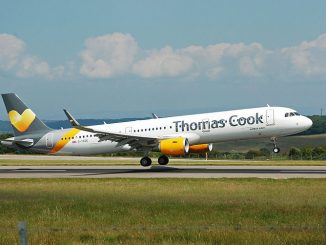 Thomas Cook Airline taking off from airport runway