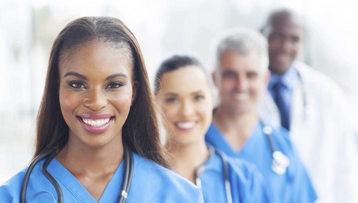 Four nurses stood next to eachother