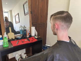 Barbers welcome back their first customers in months